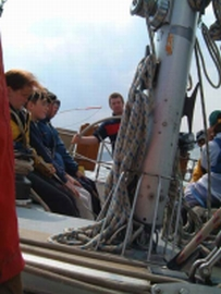 Peter McGrath on the helm of the Ocean Youth Trust North East yacht James Cook.